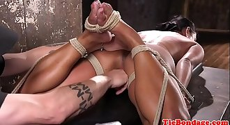 Restrained sub gagging while pussy dildoed